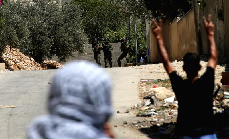NABLUS, July 27, 2018 - Israeli soldiers aim their weapons at Palestinian protesters during clashes after a protest against the expanding of Jewish settlements at Kufr Qadoom village near the West ...
