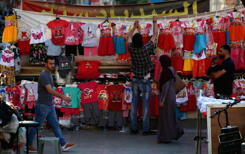 NABLUS, June 13, 2018 - A Palestinian vendor sells clothes at a market ahead of the Eid al-Fitr, which marks the end of Ramadan, in the West Bank City of Nablus, on June 13, 2018.