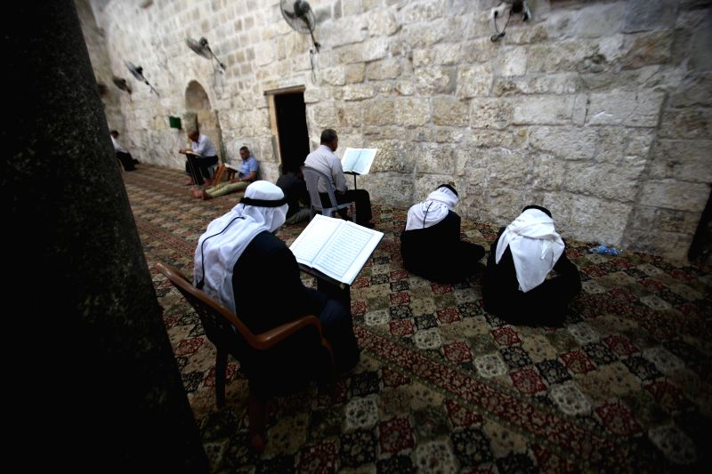 NABLUS, May 28, 2017 - Palestinian men read Quran at a mosque in the West Bank City of Nablus, on the second day of the Muslim fasting month of Ramadan, on May 28, 2017. Muslims around the world ...