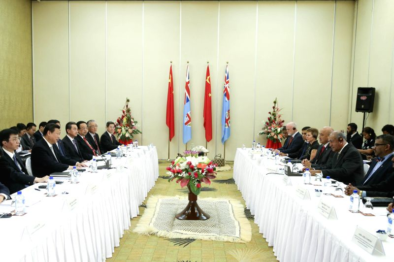 Visiting Chinese President Xi Jinping (2nd L) meets with his Fijian counterpart Epeli Nailatikau (2nd R) in Nadi, Fiji, Nov. 21, 2014.