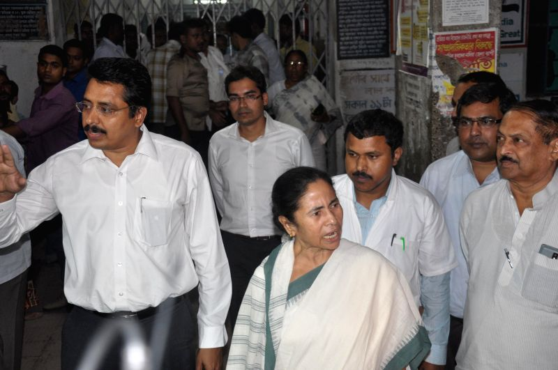 West Bengal Chief Minister Mamata Banerjee arrives to visit the nun who was gang raped in Ranaghat of West Bengal's Nadia district on March 16, 2015.