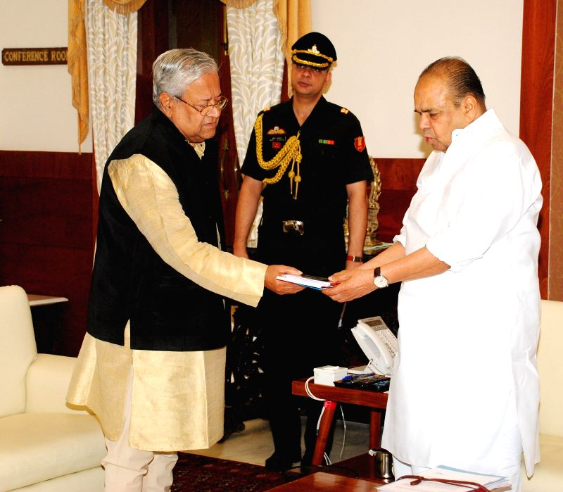 Nagaland Governor Padmanabha Acharya meets Mumbai Governor K. Sankaranarayanan at Raj Bhavan in Mumbai on August 02, 2014.