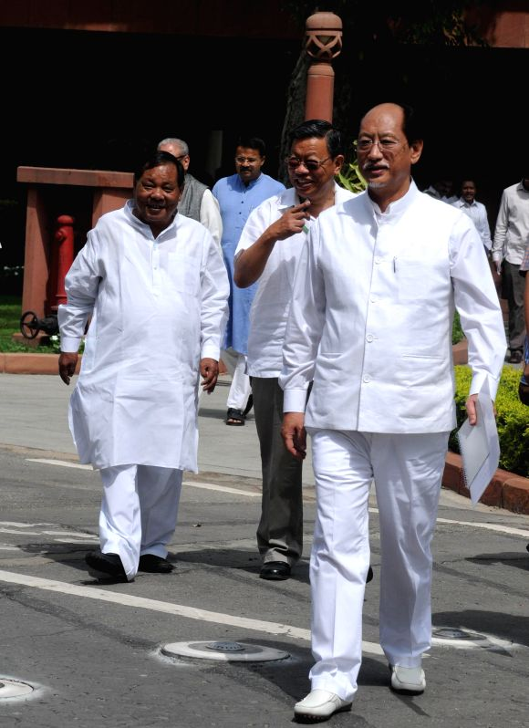 Nagaland MP Neiphiu Rio and other MPs arrive to attend the budget session of the Parliament in New Delhi on July 7, 2014.