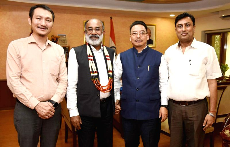 Nagaland's Tourism and Art and Culture Minister Khehovi Yepthomi calls on Union MoS Tourism Alphons Kannanthanam, in New Delhi on July 17, 2018. - Khehovi Yepthomi