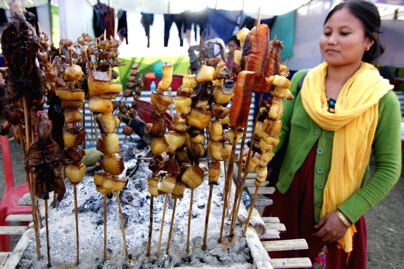 A lady stands by her stall at the North East Ethnic Food Festival 2015 in Nagaon district of Assam on Jan 20, 2015.