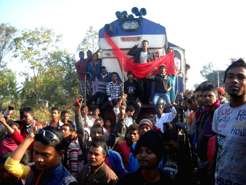 Activist of All Assam Tea Tribe Student Association stage a demonstration on railway tracks during the 12-hour Assam Bandh called by various tribal organisations to protest against the recent
