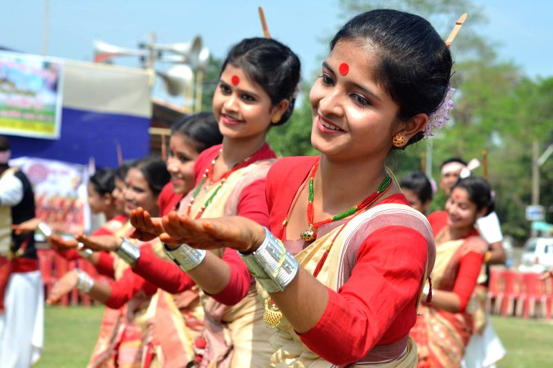 Artists perform during a programme organised to mark Rongali Bihu in Nagaon, Assam on April 15, 2015. Rongali Bihu marks the onset of the Assamese New Year and the arrival of spring.