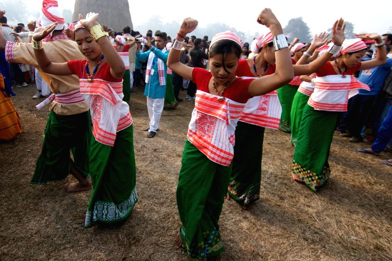 Mising tribeswomen perform their folk dance as they celebrate Bhogali Bihu in Nagaon district of Assam on Jan 14, 2015.