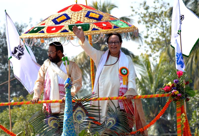 Newly elected President of Asam Sahitya Sabha Dhrubajyoti Bora waves to the crowd from the rath (chariot) while being taken to the main pandal of sabha session held at Pandit Atmaram Sarma ...