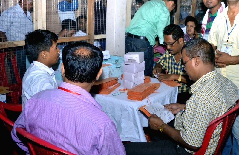 Nagaon : Officials counting postal ballots inside a counting room for the assembly elections in Nagaon District of Assam on May 19, 2016.