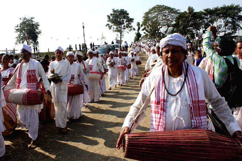 People participate in a cultural rally with their traditional musical instruments at Kaliabor in Nagaon district of Assam on Dec 4, 2014.