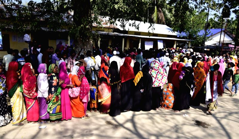 Nagaon: People stand in queue to cast vote for Lok Sabha election at a polling station in Assam's Nagaon district, on April 11, 2019. (Photo: IANS)