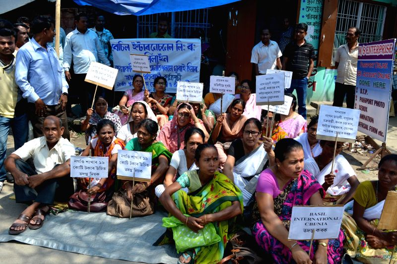 The agents of Kolkata-based Basil International Ltd stage a demonstration to demand refund of their money in Nagaon of Assam on April 9, 2015. SEBI has imposed a four-year ban on the company ...
