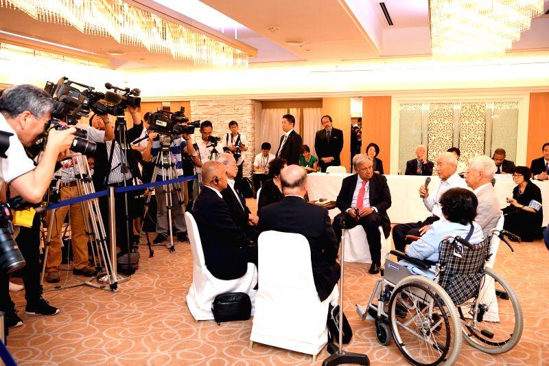 NAGASAKI, Aug. 8, 2018 - United Nations Secretary-General Antonio Guterres meets with representatives of atomic bombing victims in Nagasaki, Japan, on Aug. 8, 2018. United Nations Secretary-General ...