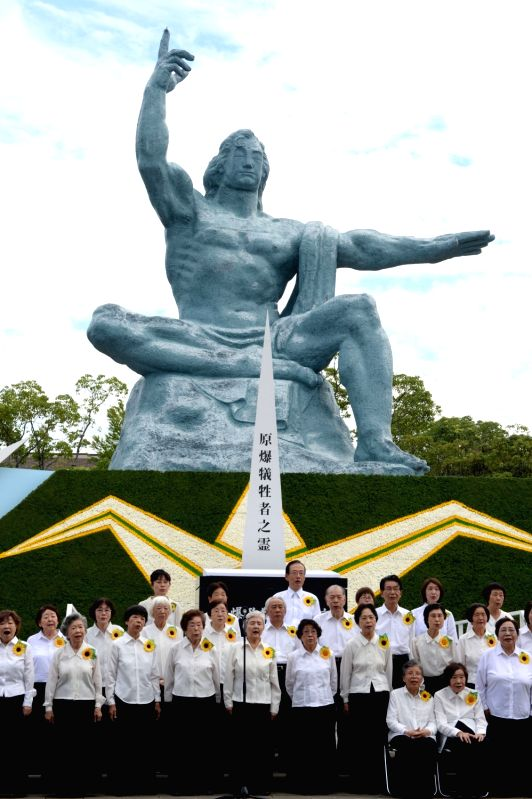 NAGASAKI, Aug. 9, 2016 - People sing a chorus to commemorate the 71st anniversary of U.S. atomic bombing at the Peace Park in Nagasaki, on Aug. 9, 2016. To accelerate Japan's surrender in the World ...
