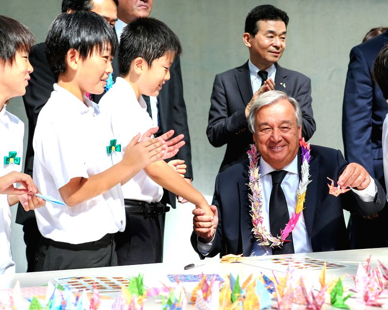 NAGASAKI, Aug. 9, 2018 - United Nations Secretary-General Antonio Guterres (R Front) makes paper cranes with local children during the 73rd anniversary of the U.S. atomic bombing of Nagasaki City in ...