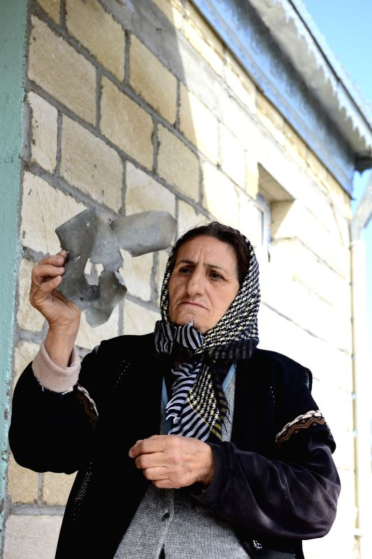 NAGORNO-KARABAKH, April 4,2016 A villager shows the debris of a shell fell near her house in Azerbaijan's Garagoyunlu village bordering Nagorno-Karabakh region on April 4, 2016. The ...