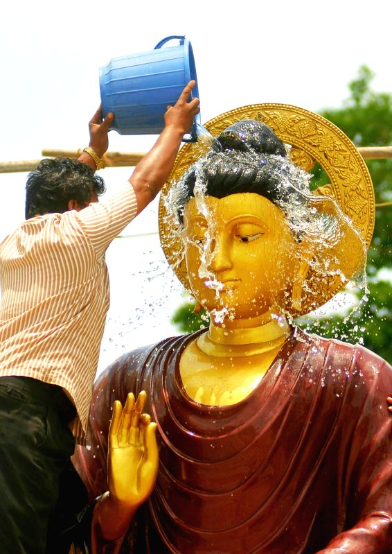 A statue of lord Buddha being cleaned at Deekshabhoomi on the eve of Buddha Purnima in Nagpur, on May 3, 2015.