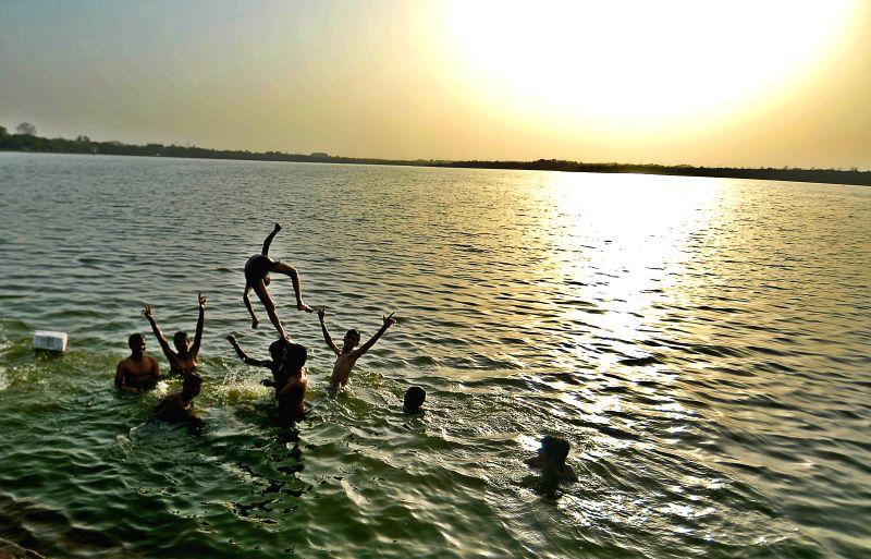 Children beat the heat in Ambazari Lake of Nagpur on April 20, 2015.