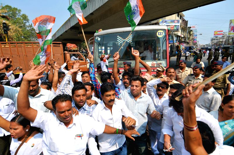 Congress workers stage a demonstration to protest against the government's failure to provide relief to the drought-affected farmers and pass benefits of falling petroleum prices to consumers