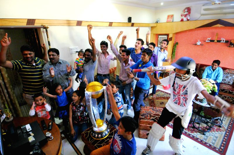 Cricket fans celebrate India's victory over Pakistan in an ICC World Cup 2015 match, in Nagpur, on Feb 15, 2015.