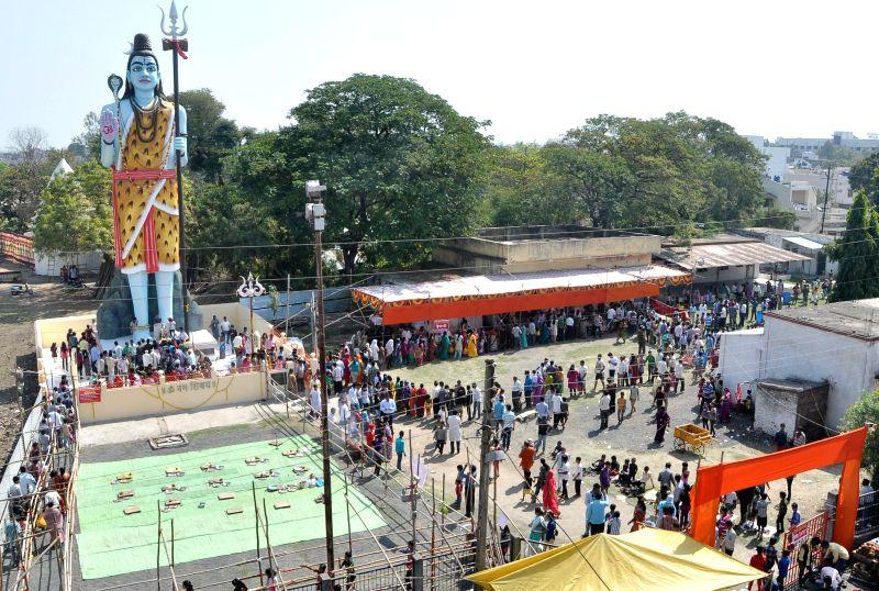 Devotees worship a 51 ft tall idol of lord Shiva on Mahashivratri in Nandanvan, Nagpur on Feb 17, 2015.