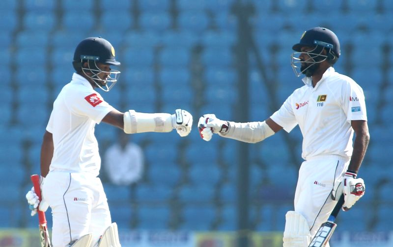 Nagpur: Dimuth Karunaratne and Lahiru Thirimanne of Sri Lanka  in action on Day 4 of the second test match between India and Sri Lanka at Vidarbha Cricket Association Stadium in Nagpur on Nov 27, 2017. (Photo: Surjeet Yadav/IANS)