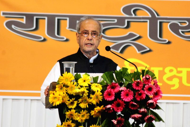 ":Nagpur: Former President Pranab Mukherjee addresses at the concluding function of RSS-organised ""Tritiya Varsh Varg"" in Nagpur on June 7, 2018. (Photo: IANS)."