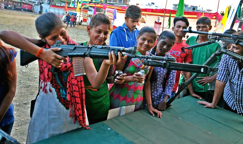 Girls at a weapons exhibition organised by State Reserve Police Force as part of Raising Day in Nagpur on Jan. 28, 2015.