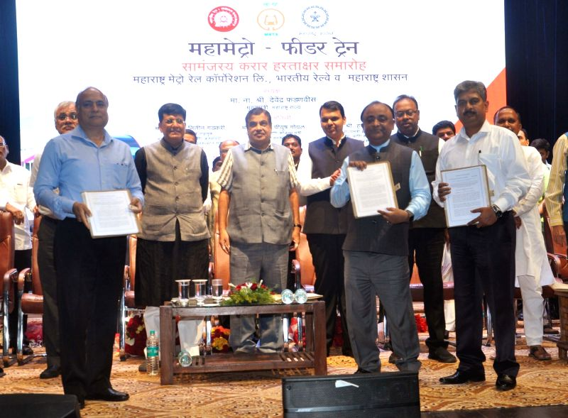 :Nagpur: Maharashtra Chief Minister Devendra Fadnavis, Union Railways Minister Piyush Goyal and Union Road Transport and Highways Minister Nitin Gadkari at the MoU signing ceremony between Indian ...
