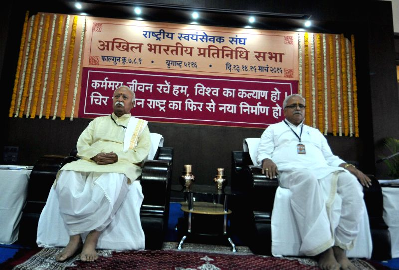 RSS chief Mohan Bhagwat and Bhaiyyaji Joshi during a programme organised by RSS in Nagpur, on March 13, 2015. - Bhaiyyaji Joshi