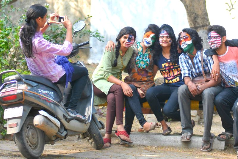 Youths with their faces painted in the colours of Indian and American flags pose for a photograph on the eve of Republic Day in Nagpur on Jan 25, 2015.