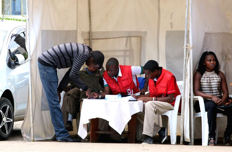 Family members of victims in the Moi University attack look for information at Kenyatta National Hospital in Nairobi, Kenya, April 3, 2015. A day-long siege of a ... - Joseph Nkaissery