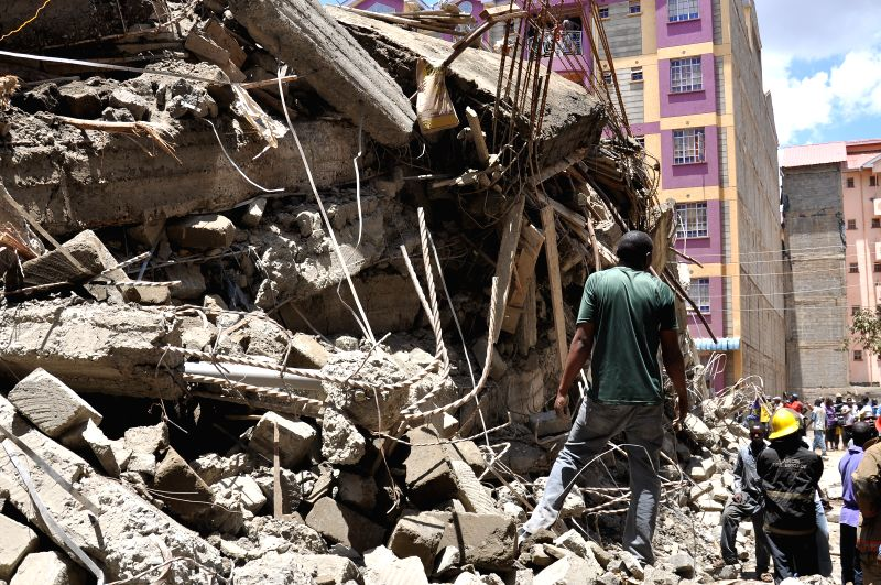 Rescue team members work at the site where a six-storey building under construction collapsed in Nairobi, Kenya, April 2, 2015. At least two people were reportedly ...