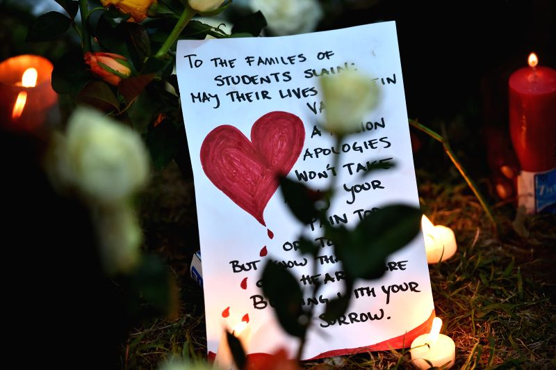 A letter to victim family is seen during a candlelight vigil for victims of the Garissa campus attack at Freedom-Corner in Uhuru Park, Nairobi, Kenya, April 7, ...