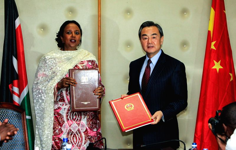 Chinese Foreign Minister Wang Yi (R) and his Kenyan counterpart Amina Mohamed attend the signing ceremony of a memorandum of understanding after their talks in ... - Wang Y