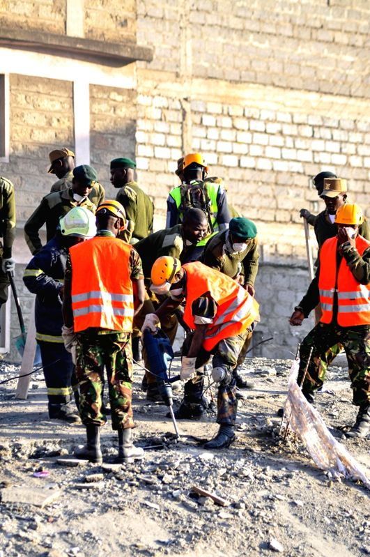 Rescuers search for survivors in the debris of a collapsed residential building in Nairobi, capital of Kenya, Jan. 5, 2015. Kenya's rescuers have retrieved two ...