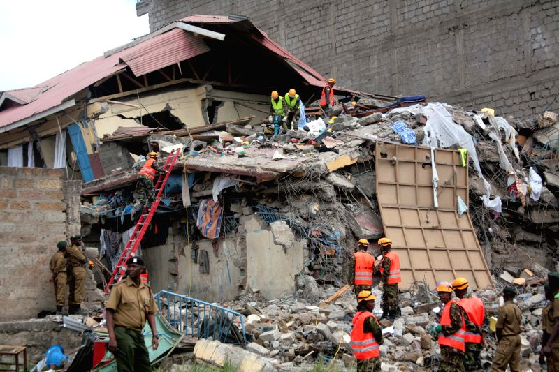 NAIROBI, June 13, 2017 - Rescuers work at the debris of a collapsed building in Nairobi, capital of Kenya, June 13, 2017. Fifteen people are still missing or feared trapped as of Tuesday in debris of ...