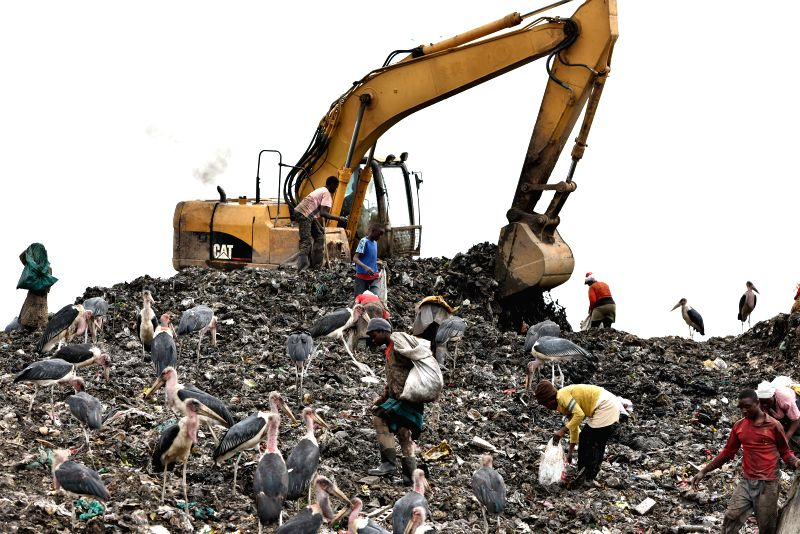 Scavengers try to collect usable things at Dandora dumpsite on the suburb of Nairobi, Kenya, June 4, 2015. The Dandora dumpsite receives about 2,000 tons urban ...