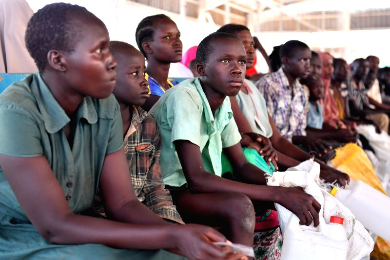 NAIROBI, June 9, 2017 - Refugees wait to receive food rations and other necessities at Kakuma refugees camp in Turkana county, Kenya, June 7, 2017. Kakuma camp is located in the north-western region ...