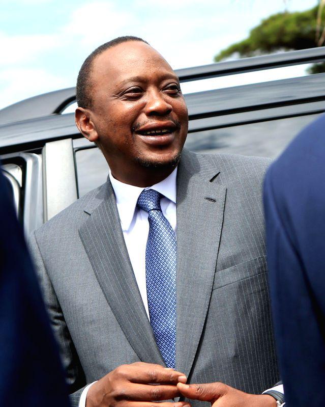 Nairobi (Kenya): File photo taken on Oct. 30, 2014 shows Kenyan President Uhuru Kenyatta attending a conference in Nairobi, Kenya. The prosecutor of the International Criminal Court (ICC) in The ...