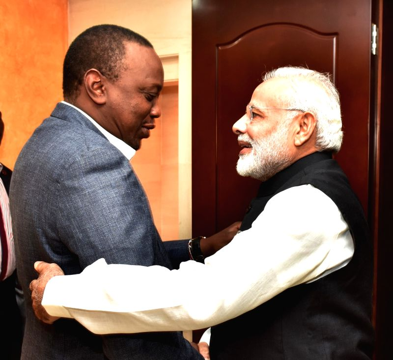 Nairobi (Kenya): Prime Minister Narendra Modi meets the President of Kenya Uhuru Kenyatta at Kasarani Stadium, in Nairobi, Kenya on July 10, 2016. - Narendra Modi