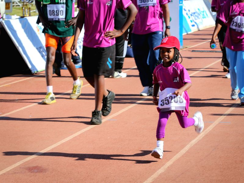 A girl runs during the Half Marathon in Nairobi, capital of Kenya, Mar. 8, 2015. Kenya celebrates the International Women's Day with a half marathon here on Sunday ...