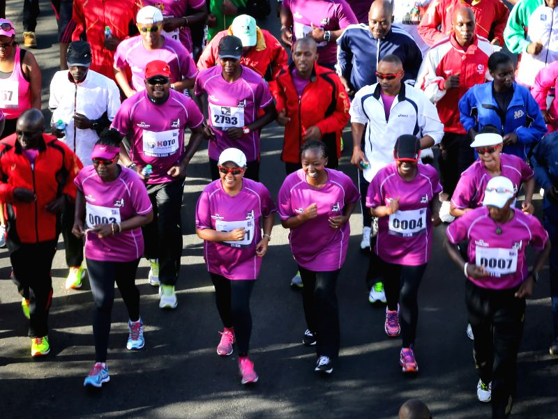 Kenya's First Lady Margaret Kenyatta (3rd L, front) runs during the Half Marathon in Nairobi, capital of Kenya, March 8, 2015. Kenya celebrates the International ...