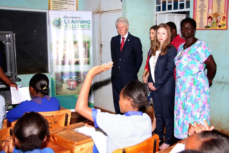 Former U.S. President Bill Clinton (1st L) and his daughter Chelsea Clinton (2nd R) visit a class at Forest Lane Primary School in Nairobi, Kenya, May 1, 2015. Former ...
