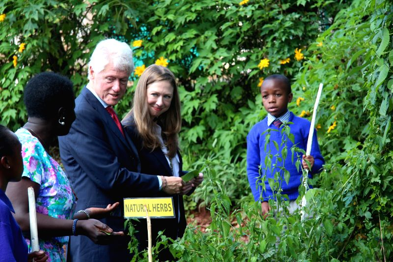 Former U.S. President Bill Clinton (3rd R) and his daughter Chelsea Clinton (2nd R) visit a farm in Forest Lane Primary School in Nairobi, Kenya, on May 1, 2015. ...