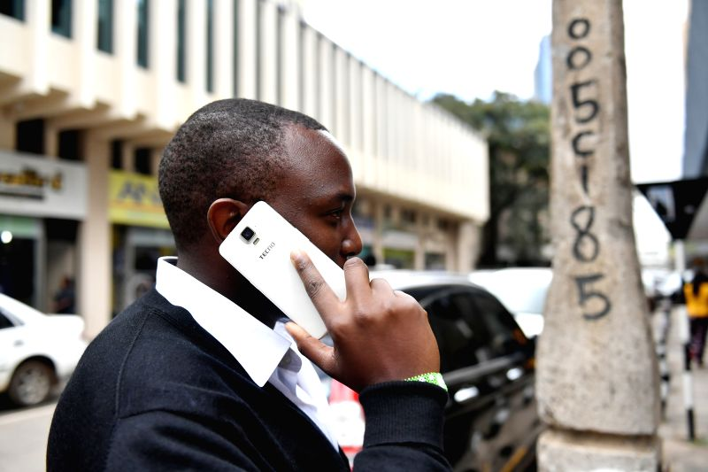 NAIROBI, May 10, 2017 - A man uses Tecno mobile phone in downtown Nairobi, capital of Kenya, May 9, 2017. Chinese mobile phone manufacturer Tecno Mobile sales reached 25 million devices, including 9 ...