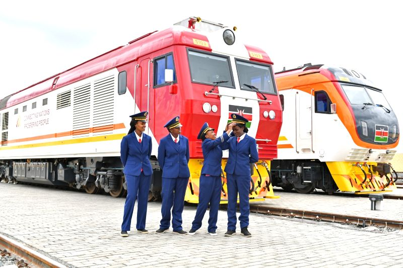 NAIROBI, May 28, 2017 - Kenyan female train driver Alice (2nd R) helps Concilia (1st R) with her hat in Nairobi, Kenya, May 17, 2017. Kenya's Standard Gauge Railway connecting Mombasa with Nairobi is ...