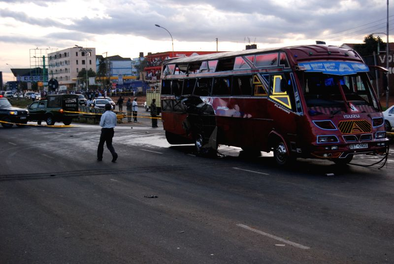 Policemen guard at a blast site in Nairobi, capital of Kenya, May 4, 2014. Two blasts that went off on buses along the Thika superhighway on Sunday evening killed at .