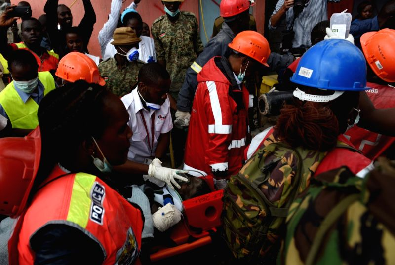 NAIROBI, May 5, 2016 - Rescuers carry a female survivor in Huruma of Nairobi, capital of Kenya, May 5, 2016. Kenya's rescuers have pulled out seven more bodies from the debris in a collapsed ...